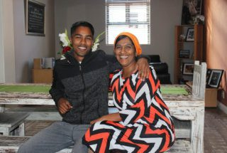 Host family, Momeena and her son, at home.