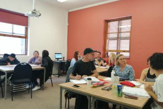 TEFL trainees in group discussions