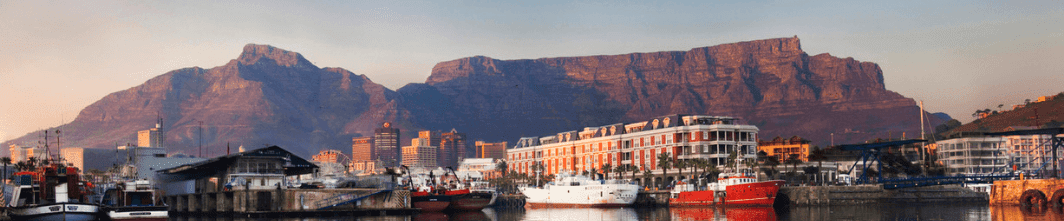 An image of the V&A Waterfront and the Cape Grace Hotel, with Table Mountain in the background