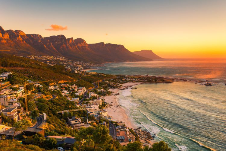 A wide picture of Clifton Beach in Cape Town, South Africa at late afternoon in a beautiful sunset. Colorful and satured taken with a Canon 6