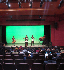 Our students watch an African drum performance in the Little Theatre on Hiddingh Campus