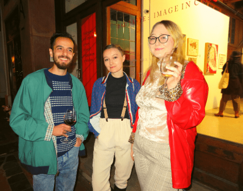Art Students mingle at a gallery show on Church Street.