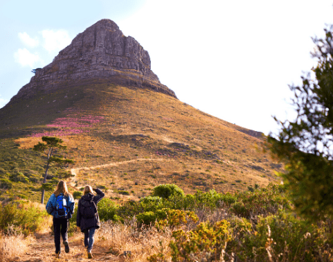 Two female students walk towards Lion's Head