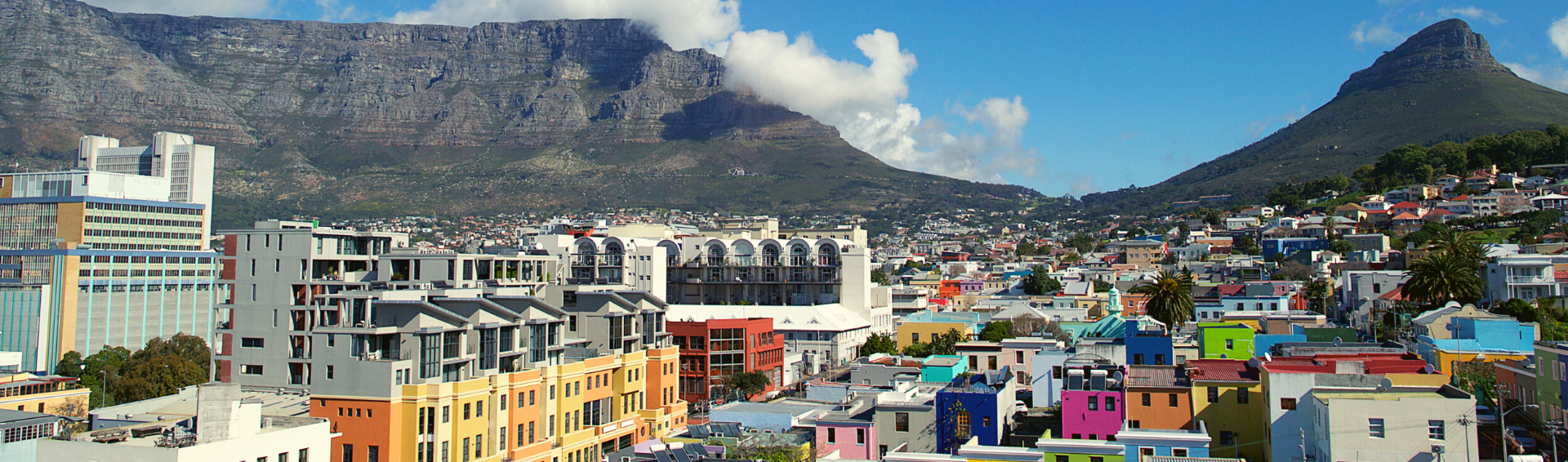 Colourful heritage site - Bo-Kaap, with Signal Hill and Table Mountain