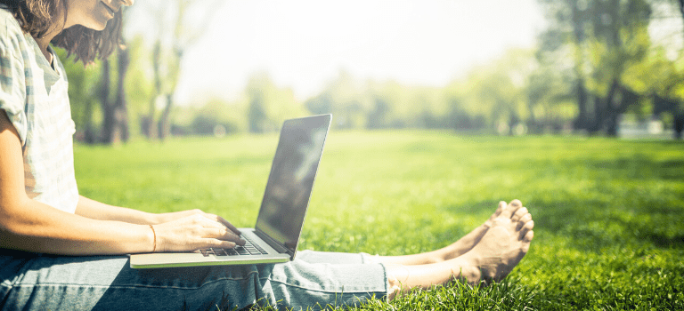 Laptop on the grass 768x350