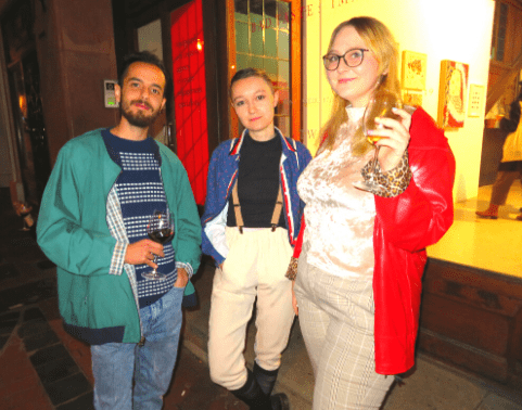 Students mingle at a gallery show