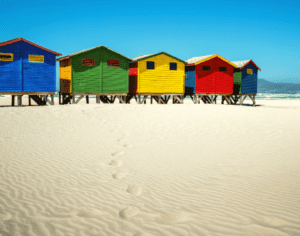 Brightly-coloured beach huts in Muizenburg, Cape Town