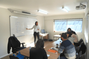 Teacher leads IELTS class