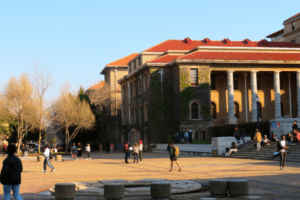 Students stroll in front of Sarah Baartman Hall