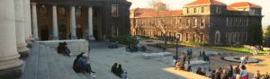 Students sit on the steps of Sarah Baartman Hall