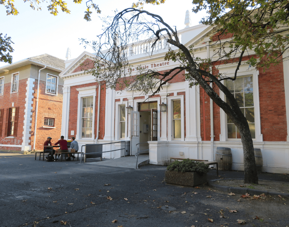Students enjoy a coffee outside the Little Theatre on Hiddingh Campus