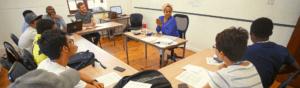 A teacher leads a conversation class