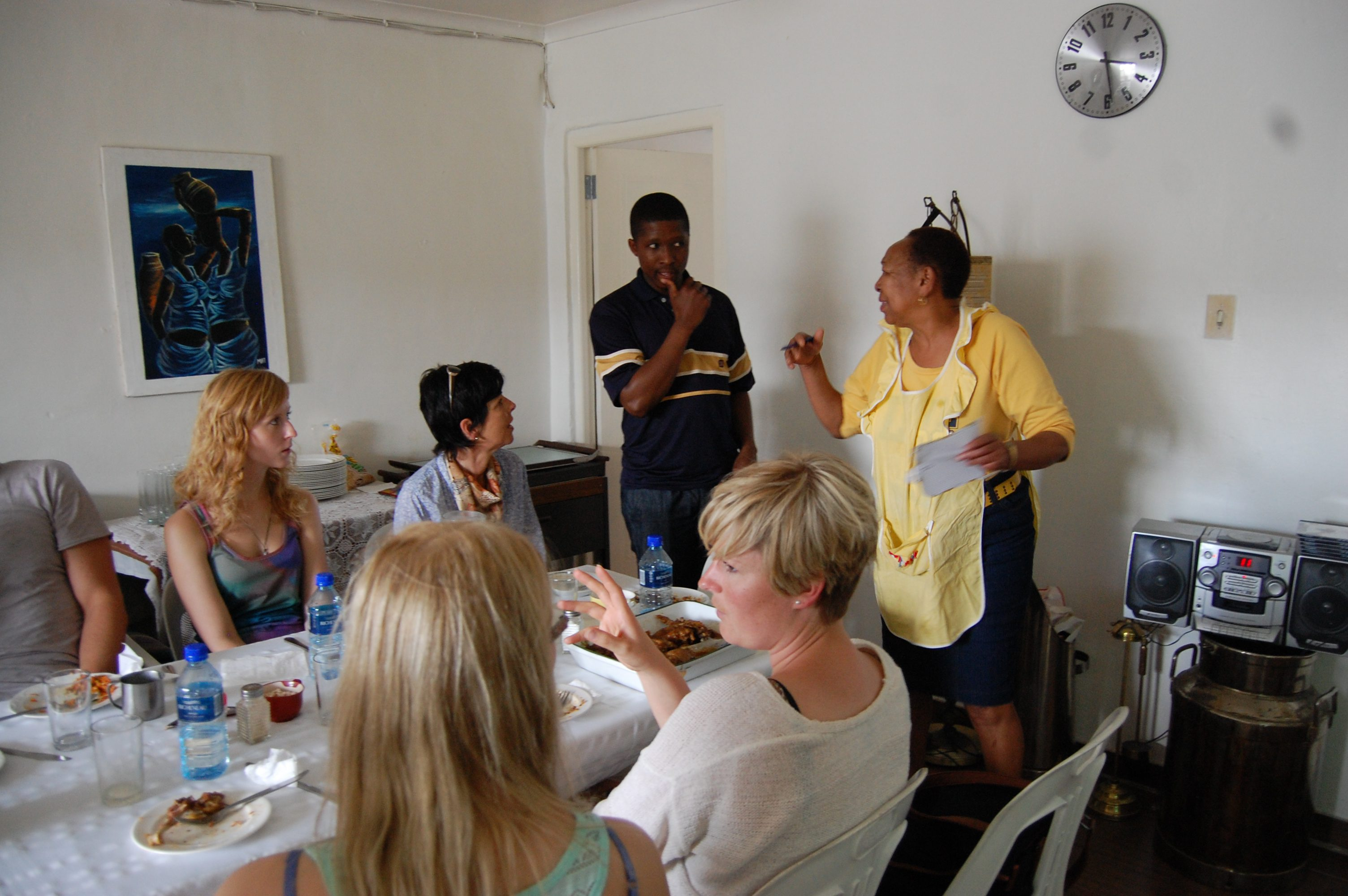 Sheila Tempi introduces a group of students to traditional isiXhosa food