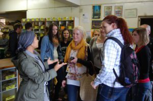 Na-iema Fakier talks to a group of students about Cape Malay cuisine in a spice shop