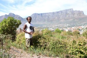 Unathi Dyanti talks about the farming of indigenous crops in Cape Town, at their garden with Table Mountain in the background