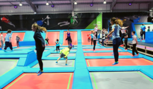 A group of people bounce about at Rush Trampoline Park