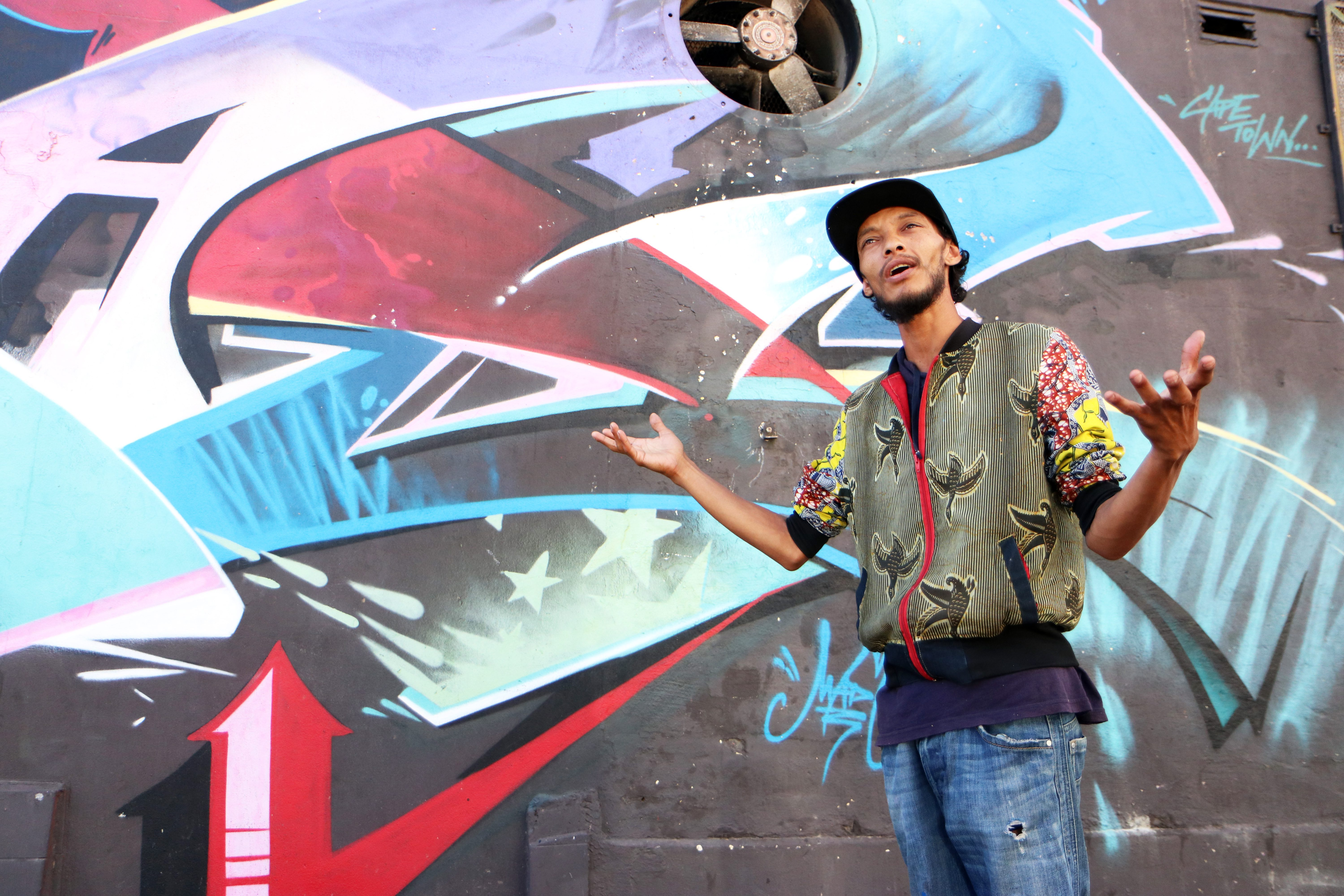 Street artist, DFeat Once, discusses grafitti in Woodstock, Cape Town