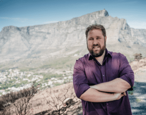 Business Development Consultant, Johannes Kraus, stands in front of Table Mountain