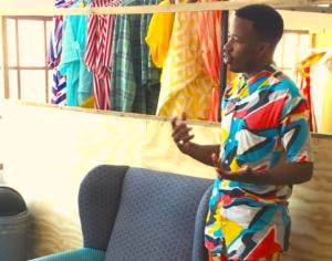 Mzukisi Mbane, a fashion designer, speaking to students on a language excursion