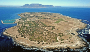 Aerial view of Robben Island with table Mountain on the distant horizon