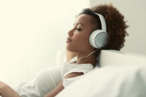 Person listening to music through a headset