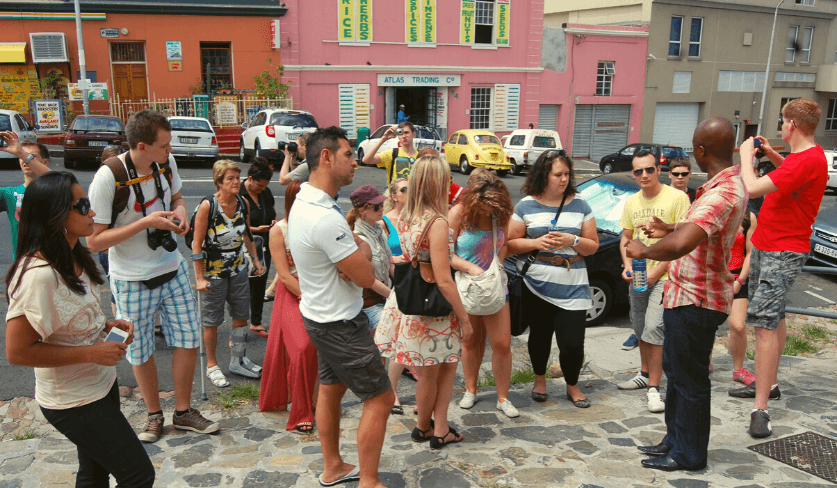 A group of students gather on the street in Bo Kaap