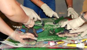Students paint sculptures at the Montebello Design Centre
