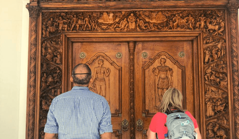 Two students gaze at an ornate piece of art at the National Art Gallery