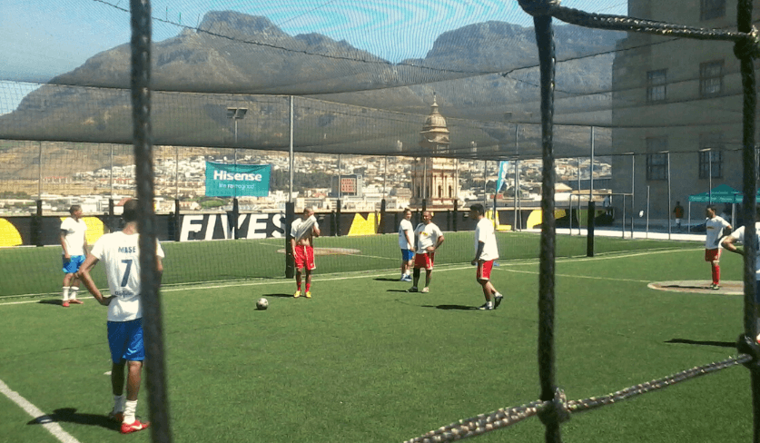 Soccer players engage in a game