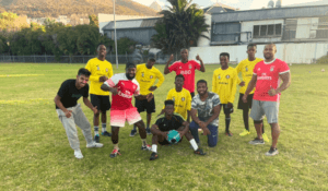 A group of students pose for a photograph on the soccer field