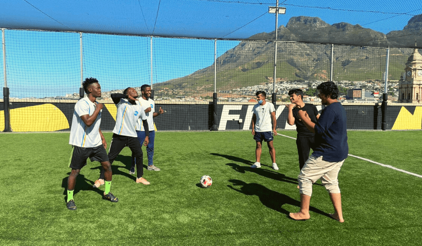 Students engaged in a game of soccer