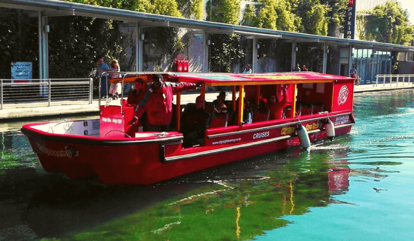 A boat cruises along the V&A Waterfront canals