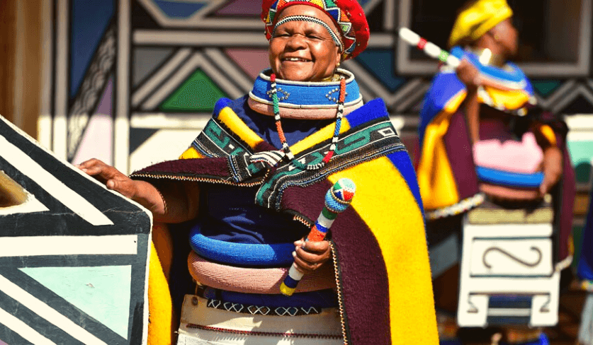A smile Ndebele woman in traditional attire