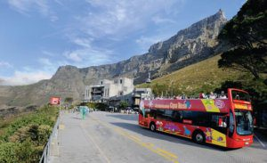 bus on a tour with table mountain in the background