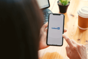Person opens LinkedIn app on their phone